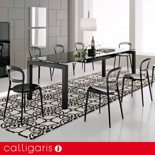 Glass dining tables by Calligaris. Airport etched
