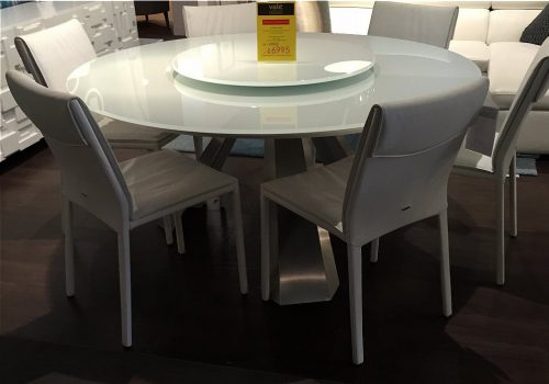 Cattelan Italia - Eliot Round dining table and Isabel leather dining chairs